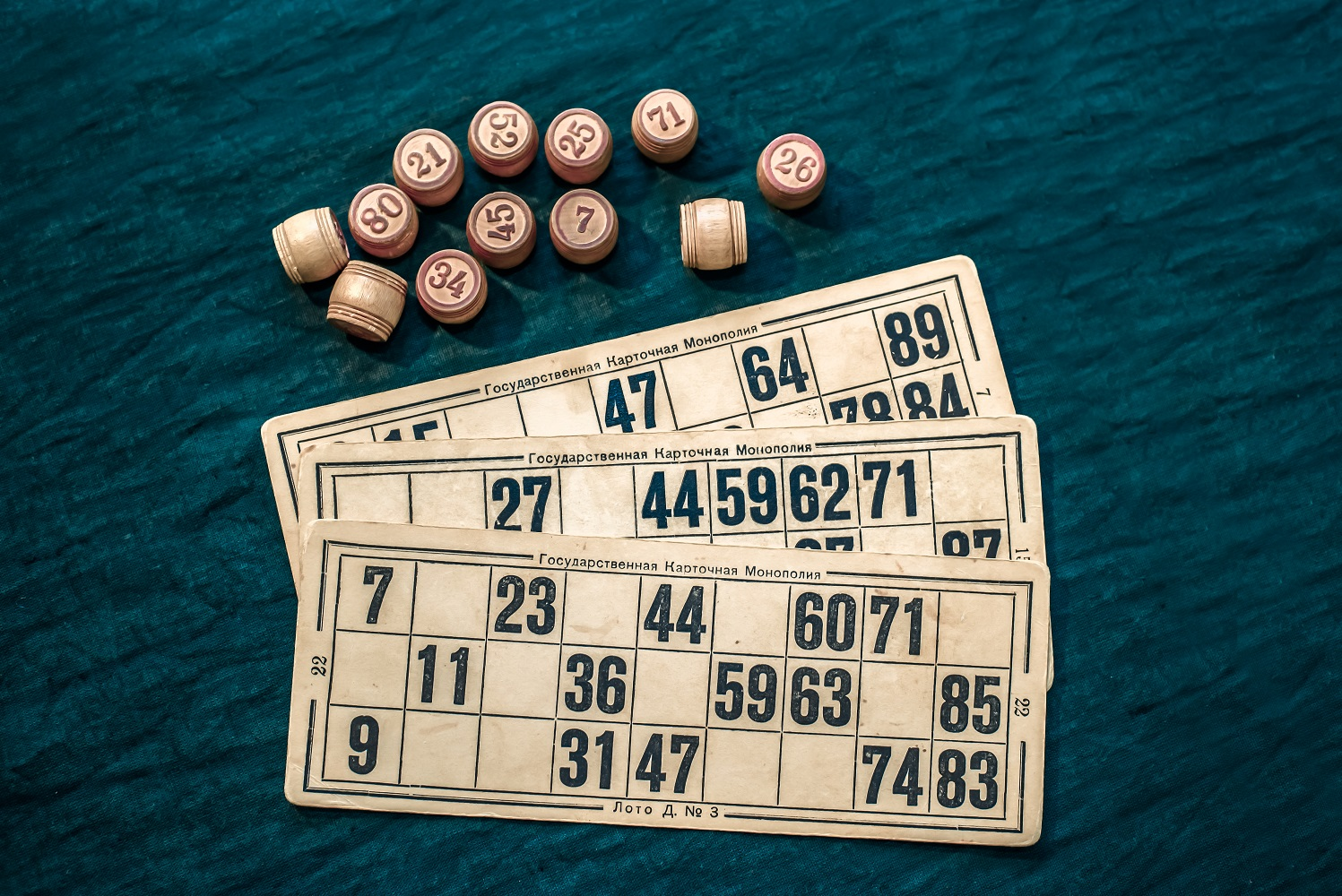 The game of bingo consists of cards and barrels with numbers on a green background, the game russian lotto